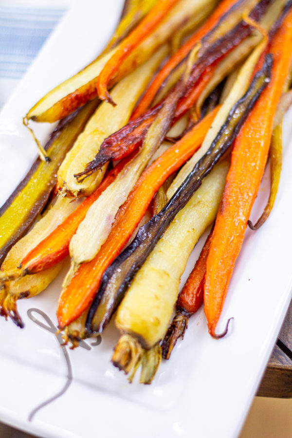 How to Make Roasted Carrots | Roasted carrots are definitely the easiest side dish, and then they are seasoned and roasted they are filled with natural sweetness and lots of flavor. This simple recipe takes just 4 ingredients and 5 minutes of active preparation time.
