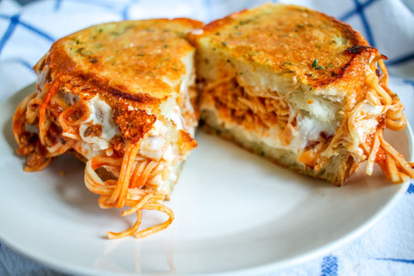 Spaghetti Grilled Cheese on Parmesan Garlic Bread is the most delicious way to serve leftover spaghetti!