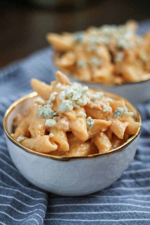 Buffalo Chicken Macaroni and Cheese is cheesy and spicy and loaded with chunks of chicken. It is a perfect 30 minute recipe that uses leftover chicken.