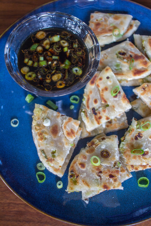 Learn how to make scallion pancakes - these crispy savory pancakes are a delicious appetizer.