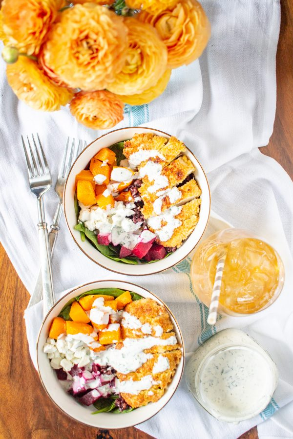 These incredibly delicious Superfood Salad Bowls with crispy chicken, beets, butternut squash, rice, goat cheese, and ranch dressing are a delicious way to pack vegetables into your meal.