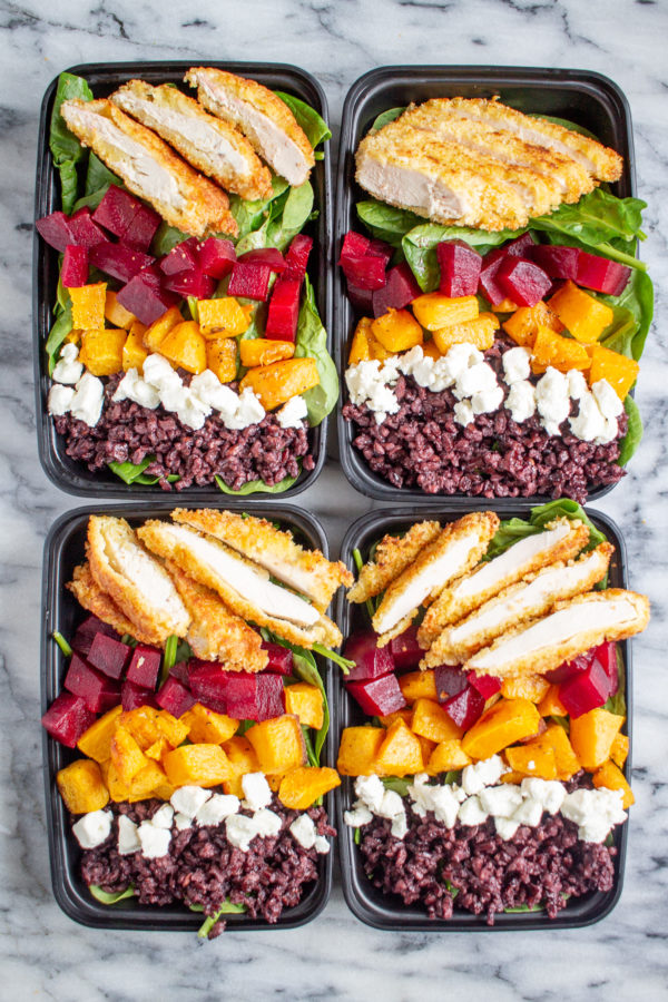 Crispy Chicken and Superfood Salads | These superfood salad bowls are a delicious way to eat your veggies. Spinach is topped with beets, butternuts squash, goat cheese, black rice, and crispy chicken - then drizzled with ranch dressing.