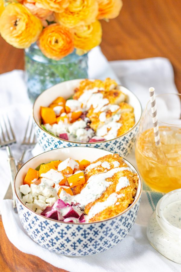 These superfood salad bowls are a delicious way to eat your veggies. Spinach is topped with beets, butternuts squash, goat cheese, black rice, and crispy chicken - then drizzled with ranch dressing.
