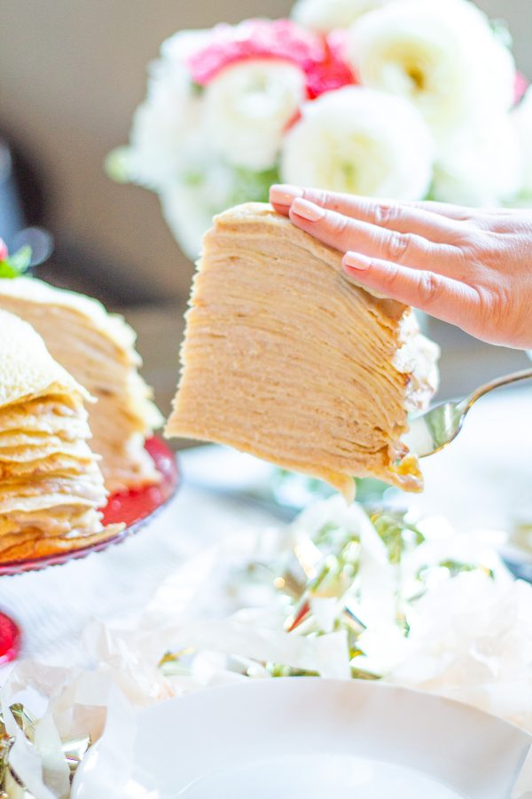 Roasted Strawberry Crepe Cake | A cake made with 25 layers of crepes filled with roasted strawberry custard. It looks so beautiful that people instantly get excited about it.
