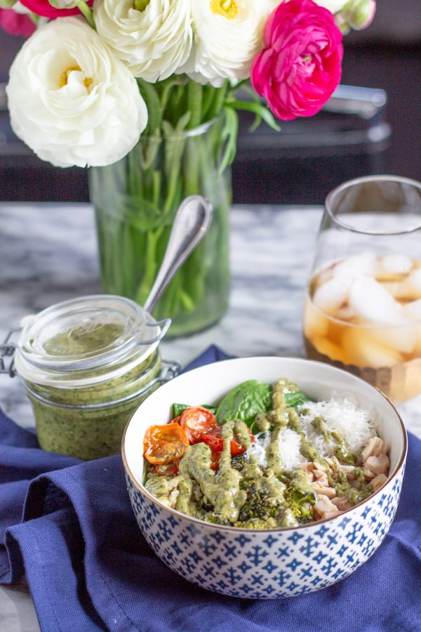 Pesto Salad Bowls are made with fresh baby spinach, quinoa, roasted tomatoes, roasted broccoli, diced chicken, parmesan, and pesto