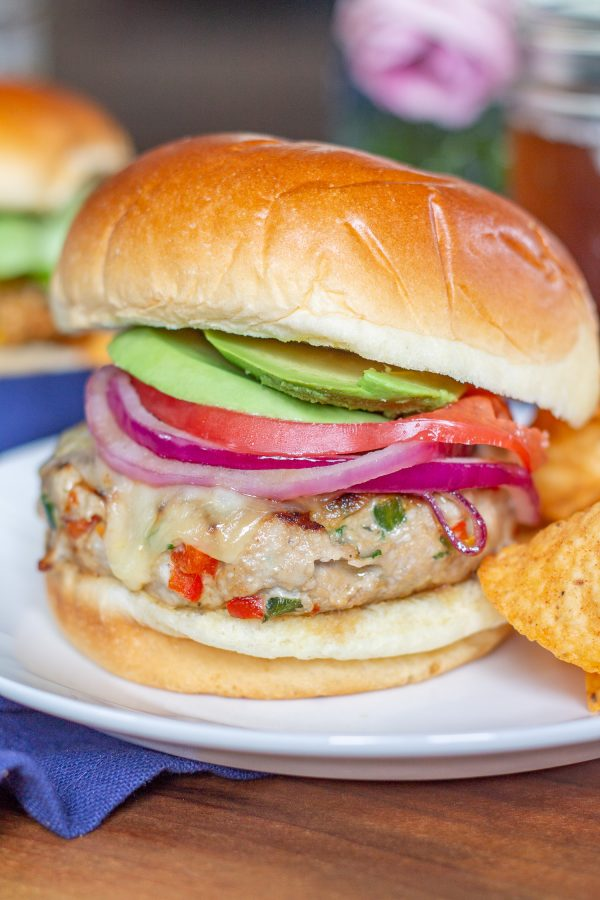 These Southwest Turkey Burgers are loaded with chopped bell pepper, poblano pepper, onion, garlic, and spices so that they are bursting with flavor. These Southwest Turkey Burgers are an easy to make healthy alternative to a beef burger.