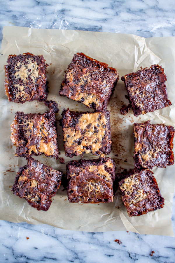 The best brownie recipe starts with a boxed mix and then you add in some secret ingredients to make extra gooey and rich brownies!