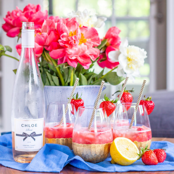 How to Make Rose Sangria | Strawberry raspberry puree, fresh strawberries and raspberries, vodka, lemon juice, and rosé come together to create a fresh and fruity Rosé Sangria that can be made in just 5 minutes.
