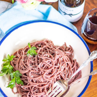 Red Wine Cacio e Pepe is a modern spin on a classic Italian recipe. The pasta is cooked in red wine, giving it a richer flavor.