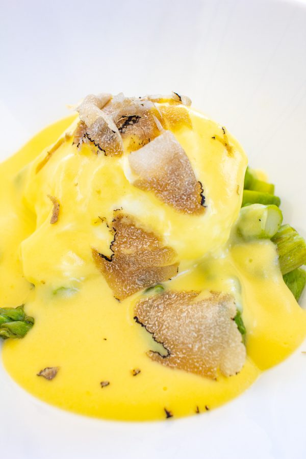 Piedmontese Foods to Try | Uovo in Camicia con Fonduta, a poached egg in a fontina fondue topped with shaved truffles