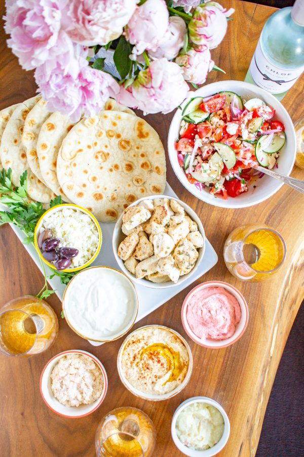 Greek Chicken Pita Recipe | Greek Chicken Pitas made with chicken marinated in yogurt, lemon, and spices and served in pita bread with tzatziki and veggies.