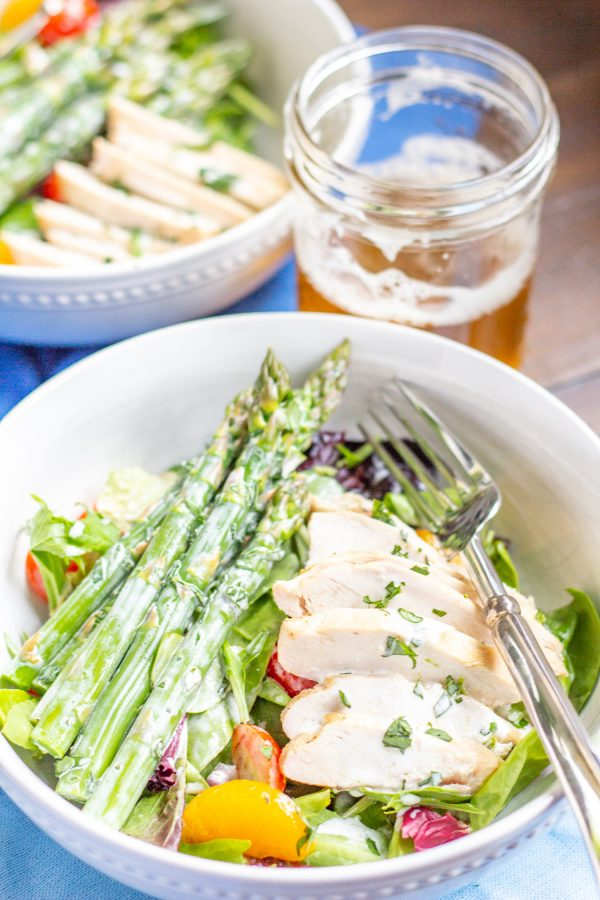 Asparagus Salad   This easy to prepare Asparagus Salad is bursting with fresh flavors. Cooked asparagus, grape tomatoes, mandarin oranges, and red onion are placed on top of mixed greens and then drizzled with a light lemon tarragon yogurt dressing. Serve it as a side dish, or add chicken or salmon to turn it into a complete meal.