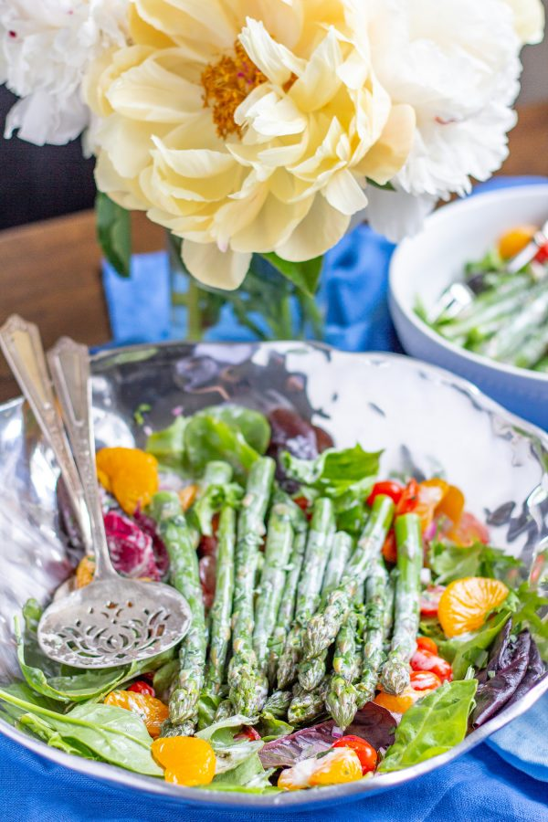 Asparagus Salad | This easy to prepare Asparagus Salad is bursting with fresh flavors. Cooked asparagus, grape tomatoes, mandarin oranges, and red onion are placed on top of mixed greens and then drizzled with a light lemon tarragon yogurt dressing. Serve it as a side dish, or add chicken or salmon to turn it into a complete meal.