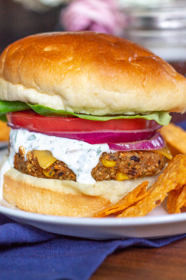 Sweet Potato and Black Bean Veggie Burgers are a great way to eat your veggies. These burgers are made by combining sweet potatoes, black beans, corn, shallots, garlic, quinoa, and old-fashioned oats. It is a plant-based meal that you feel good about eating.