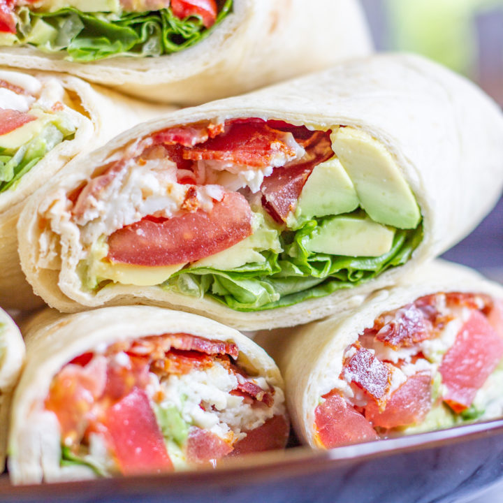BLT Wraps | The classic BLT gets an upgrade with this easy recipe forBLT Wraps with Avocado and Mozzarella. This is the perfect low-fuss summertime meal. Crispy bacon gets paired with juicy tomatoes, fresh lettuce, slices of avocado, creamy fresh mozzarella cheese, and a touch of mayonnaise. It is a medley of well-loved ingredients, and a perfect way to serve ripe end-of-summer tomatoes. When my friend was hosting a picnic in Lincoln Park, I wanted to bring one of my favorite summertime foods, the BLT. Instead of just adding bacon, lettuce, and tomato, I also addedin some shredded fresh mozzarella, and some slices of avocado. And since BLTs have a tendency to fall apart, I made BLT wraps so that I could add more ingredients without worrying about the sandwiches falling apart. I love this recipe because it is easy to make enough to serve a crowd. The only cooking involved in this recipe is cooking the bacon, which can easily be done in large batches. Once the bacon is ready, you can assemble enough wraps to feed the whole family in just 10 minutes. The easiest way to prepare the bacon is to bake it on a sheet pan. While the bacon is cooking, chop the tomatoes, wash the lettuce, grate the mozzarella, and slice the avocado. Once the bacon has cooked, let it cool and then assemble the BLT Wraps. I like to let the bacon cool so that way it doesn't melt the mozzarella. I recommend making these BLT Wraps just before serving, otherwise, the juicy tomato might make the wrap and bacon soggy. And, use the largest tortillas that you can find. I like to buy the Burrito Grande size since they are just the right size to hold lots of ingredients. I am not going to get into specific proportions in the recipe, you can make these BLT Wraps however you like - I recommend preparing 2-3 slices of bacon per wrap. How to makeBLT Wraps with Avocado and Mozzarella: Bacon Tomatoes Avocado Lettuce Fresh Mozzarella Mayonnaise Large Tortillas Begin by preparing the bacon. Line a baking sheet wit