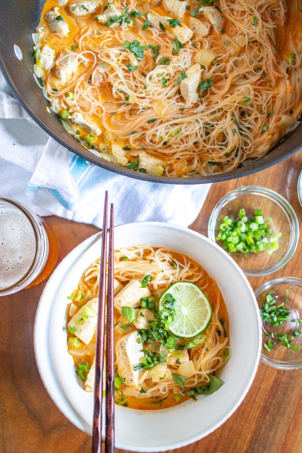 Thai Curry Noodle Soup with Chicken | We are obsessed with this Thai Curry Noodle Soup with Chicken recipe. It's so flavorful - it's spicy, creamy, and citrusy with thin strands of rice noodles and chunks of tender chicken. It is also an easy to prepare weeknight meal that is anything but boring.