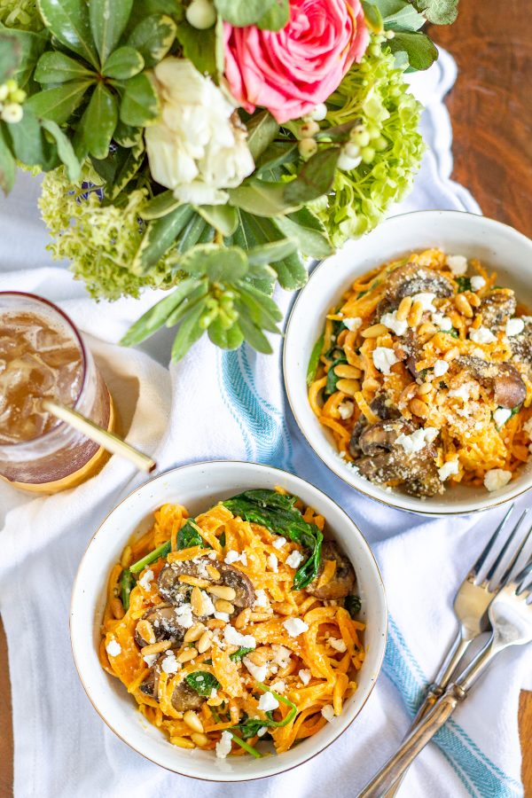 Sweet Potato Noodles with a Goat Cheese Sauce, Mushrooms, Spinach, and Pine Nuts