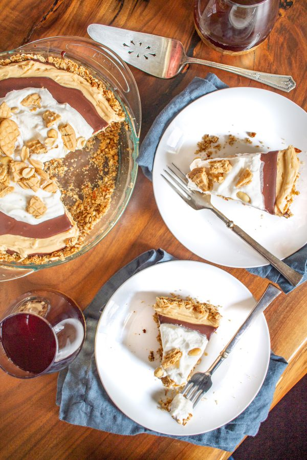 Chocolate Peanut Butter Pie | This Chocolate Peanut Butter Pie combines creamy peanut butter, rich chocolate, and light fluffy whipped cream in a salty pretzel crust. The best thing is that this pie comes together in just minutes.