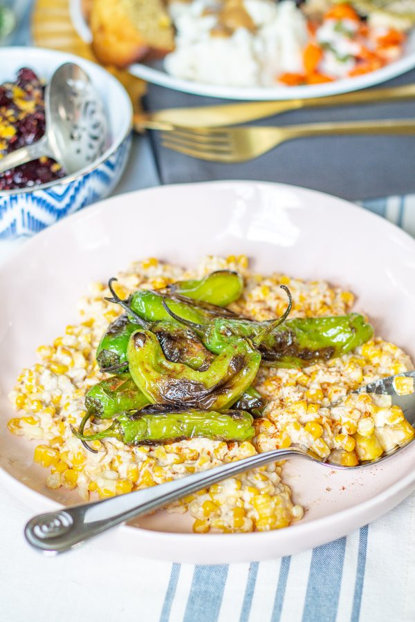 Creamy Parmesan Lime Corn and Shishito Peppers | This Creamy Parmesan Lime Corn and Shishito Peppers recipe brings together fresh corn in a creamy and citrusy Parmesan lime sauce and blistered shishito peppers. #thanksgiving