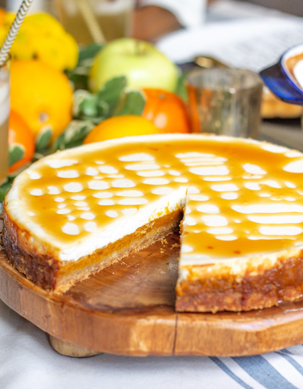 Reduced Fat Pumpkin Cheesecake | This cheesecake is has a layers of pumpkin filling and a fresh creamy yogurt cheesecake. It's a lighter healthier dessert to serve your family this #Thanksgiving.