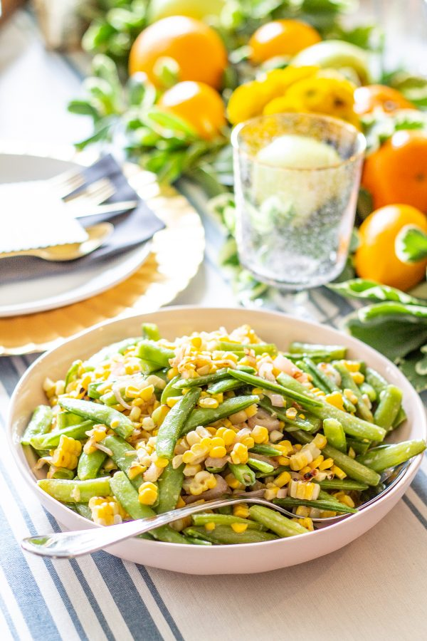Sugar Snap Pea and Corn Salad | This Sugar Snap Pea and Corn Salad with caramelized shallots and a citrus yogurt dressing is an untraditional addition to Thanksgiving dinner that my family loves.