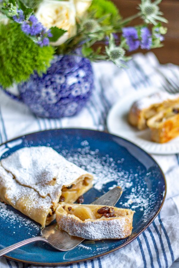 How to Make Apple Strudel | This German Apple Strudel recipe is made with tender apples, crème fraîche, and raisins wrapped up in a light thin pastry.