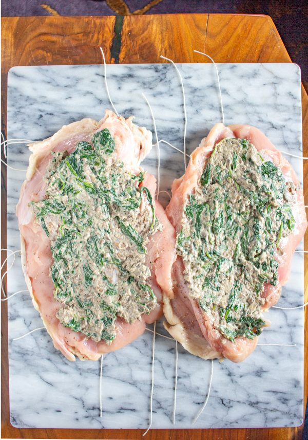 This Mushroom Spinach Stuffed Turkey Breast is a fun alternative to serving a whole turkey at Thanksgiving or Christmas. A turkey breast is stuffed with a cheesy mushroom spinach dip and then roasted. It is loaded with flavor and it pairs well with gravy and mashed potatoes!
