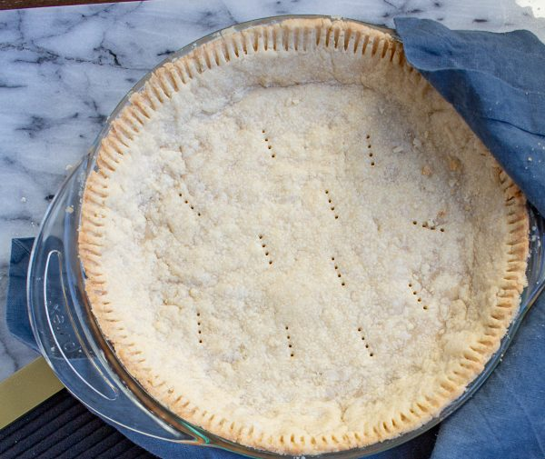 This 4 ingredient no roll pie crust recipe is the easiest way to make a pie crust from scratch! This shortbread pie crust makes holiday baking much easier!