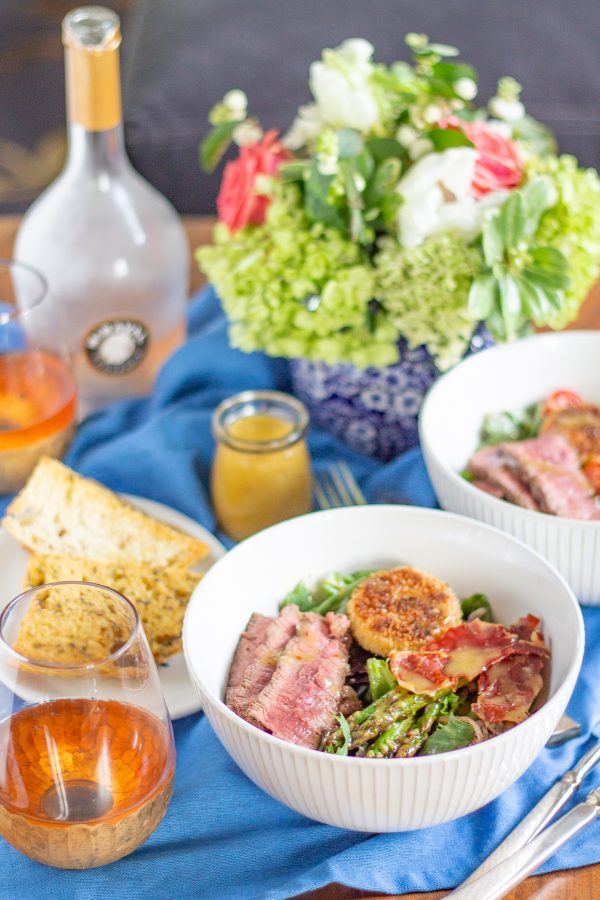 Steak and Fried Goat Cheese Salad a complete meal with greens, asparagus, tomatoes, crispy prosciutto, fried goat cheese, steak, and a light roasted garlic and mustard dressing.