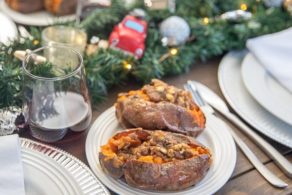 Twice Baked Sweet Potatoes are mashed with butter, maple syrup, and sea salt, and then topped with a butter, pecan, and brown sugar topping. It's the ultimate combination of sweet, salty, and nutty flavors.