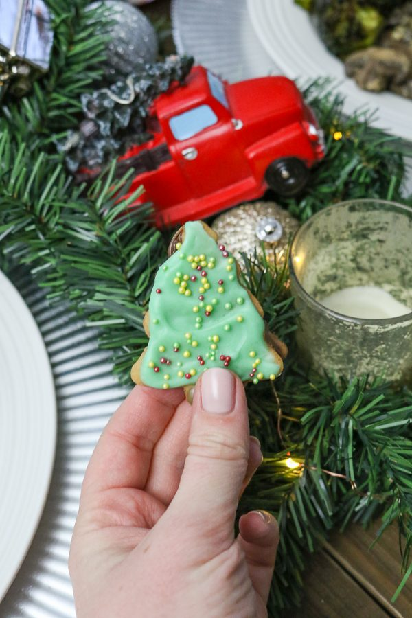 Christmas Tree Sugar Cookie Sandwiches | These Christmas tree shaped sugar cookie sandwiches are filled with Nutella and topped with white chocolate and sprinkles - they are just the cookie to serve at a holiday party or to bring to a cookie swap. #cookies #christmascookies