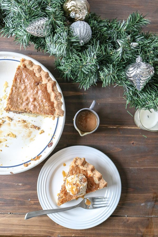 Toll House Cookie Pie is a classic dessert that combines two of the best desserts in the world: cookies and pie! It is gooey in the middle, filled with crunchy walnuts, and slightly crisp on top, combining all the best flavors and textures of a chocolate chip cookie. #pie #dessert