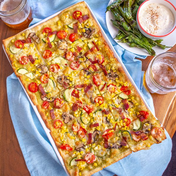 How to Make Mexican Flatbread | This Mexican Flatbread has bold flavors and plenty of vegetables. It will be a welcome addition at your next party.