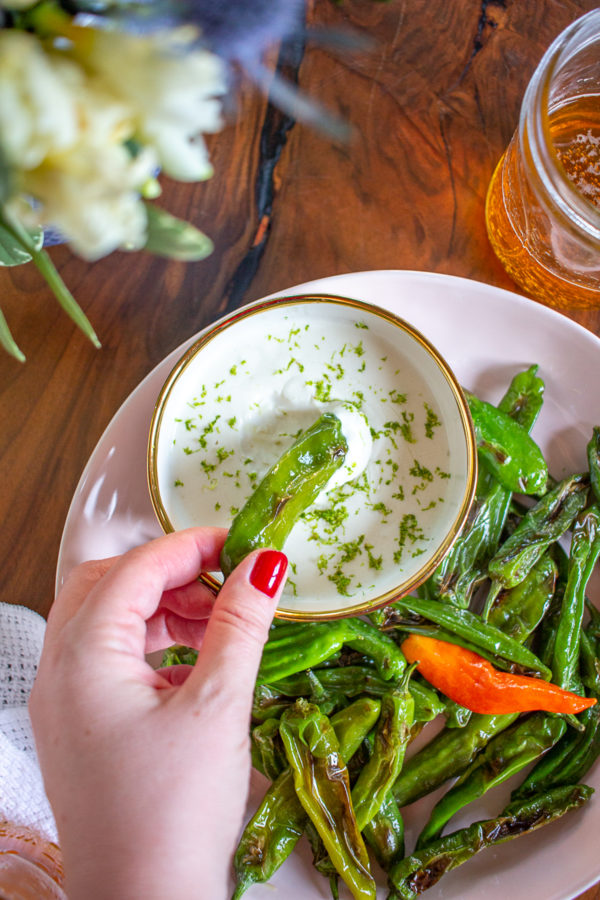 These Shishito Peppers with a Parmesan Lime Sauce for dipping are an on-trend appetizer to serve at your next party.