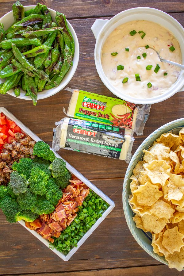 How to Make Queso | Your friends and family will love this easy game-day queso recipe and queso bar ideas! Warm melted queso made with @cabotcheese is delicious over chips, baked potatoes, tacos, and hot dogs. This recipe is a great addition to any party!