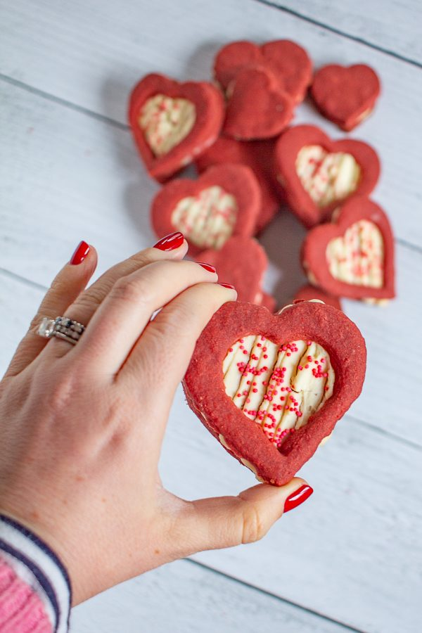 Red Velvet Shortbread Cookies with Cheesecake Filling are a Valentine's Day treat your sweetheart will love. These cookies take the flavor of a red velvet cupcake, and put it into a cookie.