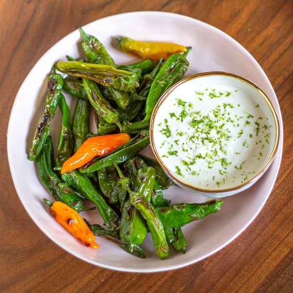 Shishito Peppers with a Parmesan Lime Sauce | These Shishito Peppers with a Parmesan Lime Sauce for dipping are an on-trend appetizer to serve at your next party.