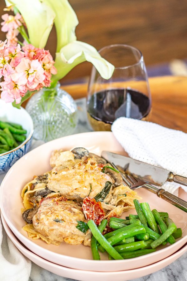 Marry Me Chicken with Veggies | The internet has been all abuzz about Marry Me Chicken, a creamy cheesy chicken dish made with sundried tomatoes. I added extra veggies and a secret ingredient to create my own version.