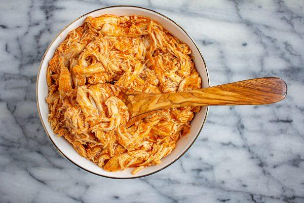 How to make Crock Pot Buffalo Chicken| Learn an easy 3 ingredient, 5 minute, recipe for Crock Pot Buffalo Chicken.