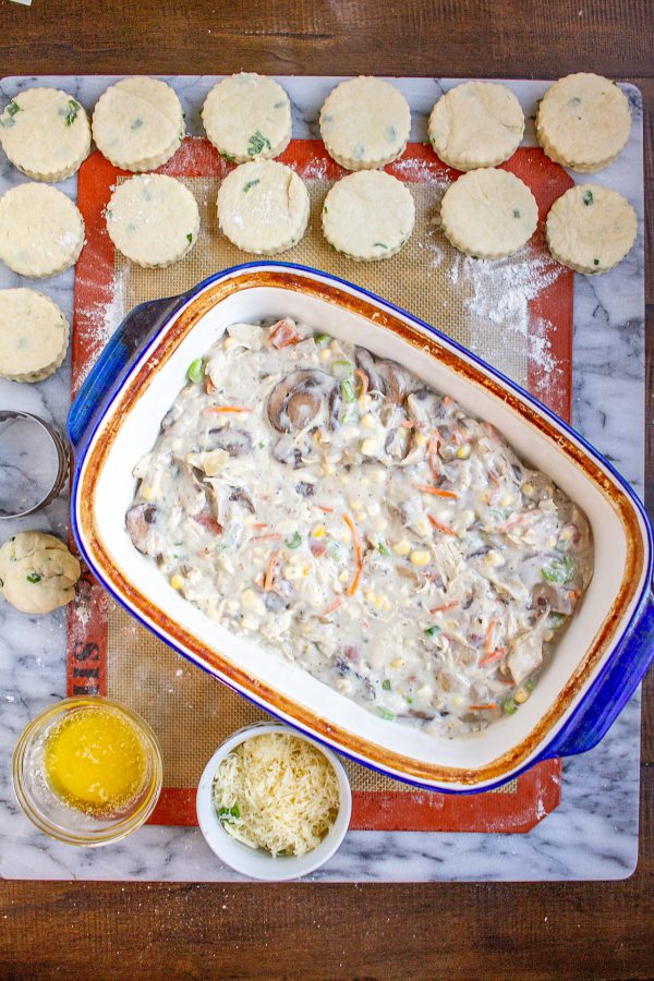 Chicken Bacon Ranch Biscuit Casserole combines all my favorite food groups into one comfort food casserole. The chicken filling is made with shredded chicken, bacon, mushrooms, celery, corn, onion, and corn in a creamy ranch sauce.