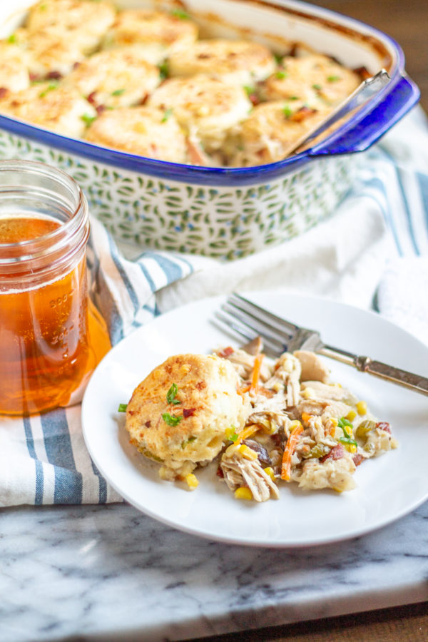Chicken Bacon Ranch Biscuit Casserole combines all my favorite food groups into one comfort food casserole.The chicken filling is made with shredded chicken, bacon, mushrooms, celery, corn, onion, and corn in a creamy ranch sauce.