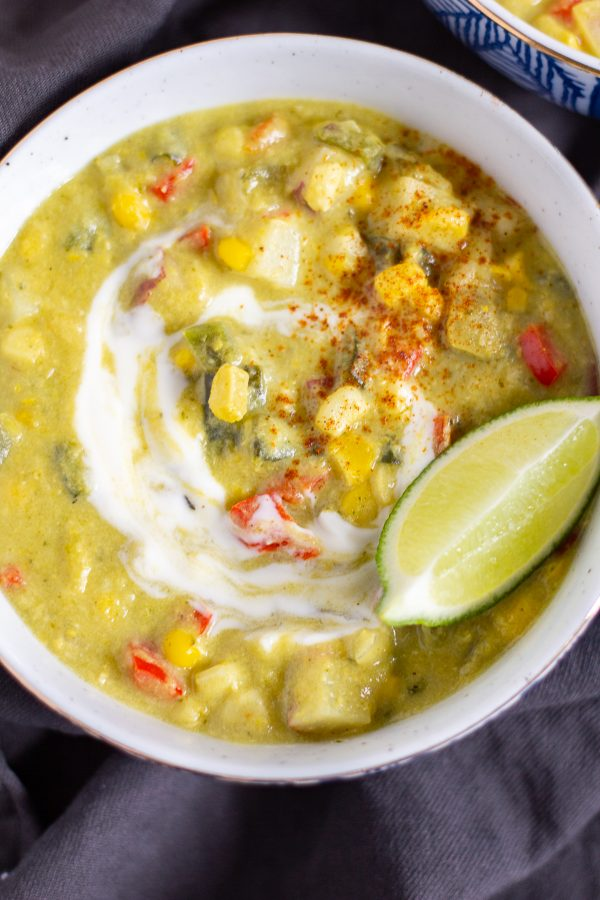 Roasted Poblano Corn Chowder is a creamy soup filled with smoky fire roasted poblano peppers, fresh corn, tender diced potatoes, and crisp bell pepper.