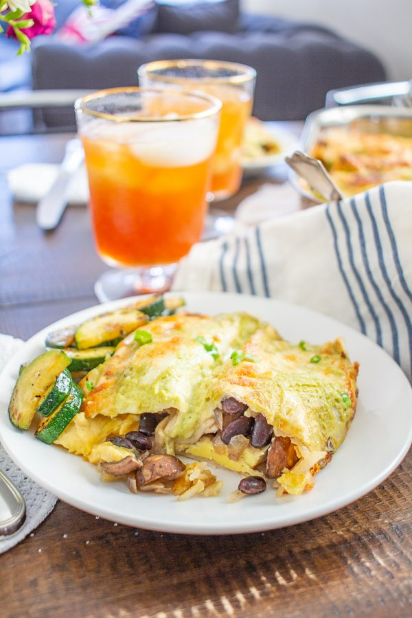 Breakfast Enchiladas are a hearty breakfast (or brunch) that feeds a crowd. It's perfect for times when you are hosting guests, or nights when you want to have breakfast for dinner.