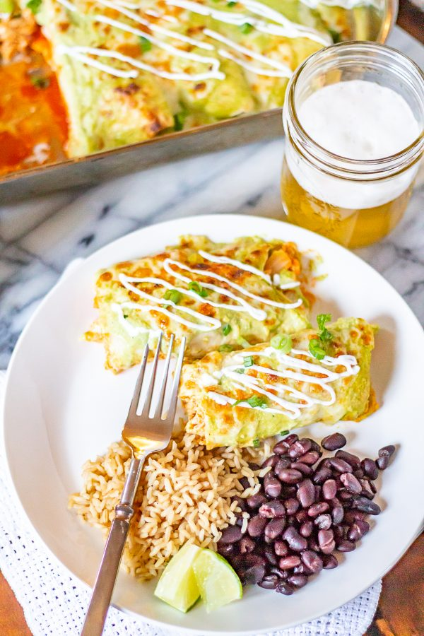 Buffalo Chicken Enchiladas is an easy Tex-Mex dinner recipe that has just the right amount of spice. These enchiladas are filled with creamy spicy buffalo chicken and topped with a poblano cream sauce. #enchiladas #buffalochicken