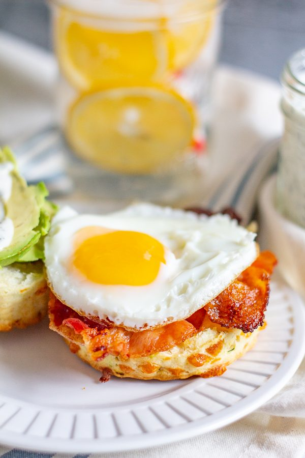 The Best Breakfast Sandwich   This meal is a way to get your day off to a great start. This breakfast sandwich is made with a fried egg, bacon, and avocado on a homemade cheddar cheese and green onion biscuit. The finishing touch is a drizzle of ranch dressing.