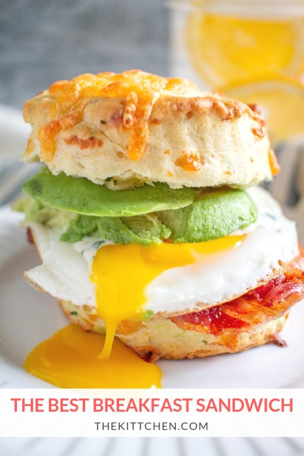 The Best Breakfast Sandwich | This meal is a way to get your day off to a great start. This breakfast sandwich is made with a fried egg, bacon, and avocado on a homemade cheddar cheese and green onion biscuit. The finishing touch is a drizzle of ranch dressing.