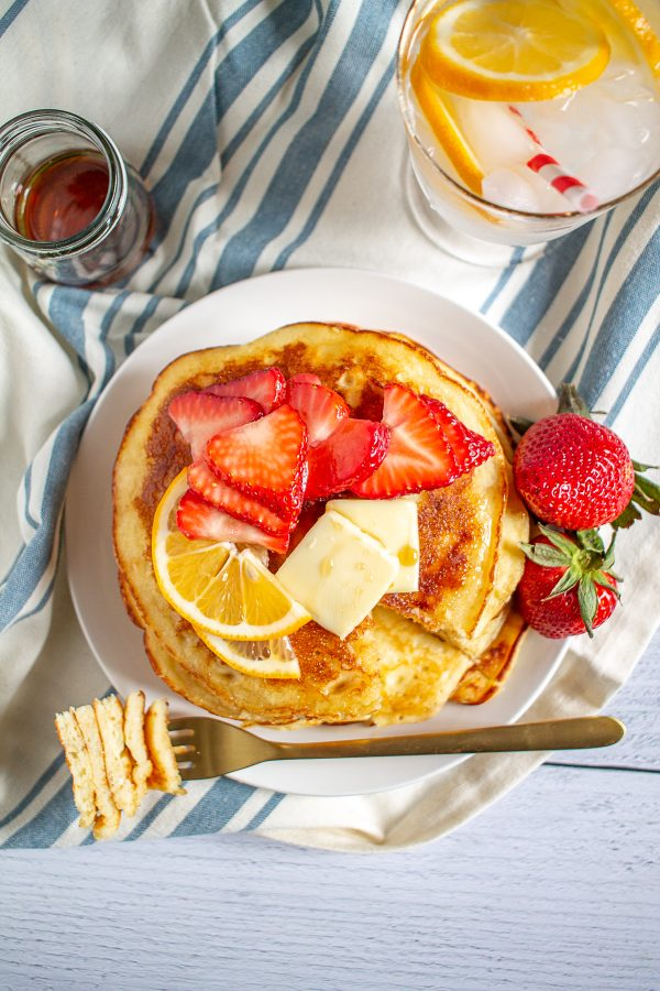 Lemon Ricotta Pancakes are a weekend brunch that will make a lazy Saturday morning feel special. The ricotta gives the pancakes a light, almost spongy texture. The ricotta flavor is mild, while the bold taste of lemon takes center stage.