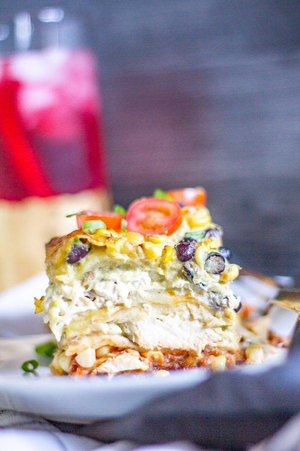 Chicken Mexican Lasagna is a delicious meal made with shredded chicken coated in poblano cream sauce layered between flour tortillas with black beans, corn, salsa, and cheese.