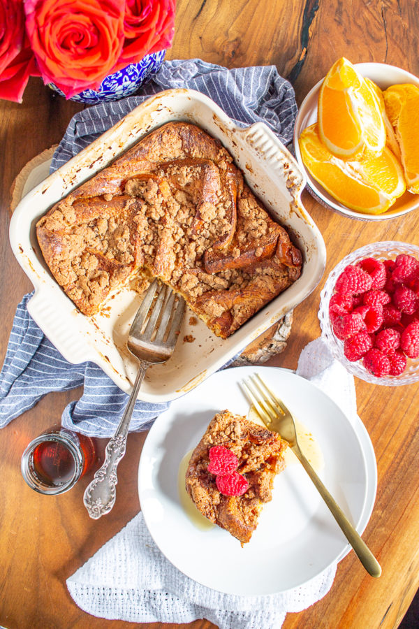 This Overnight Baked French Toast makes weekend mornings extra special. It's a decadent meal made with classic baked french toast topped with a cinnamon streusel topping. As it bakes, it fills your home with a delicious scent worth getting out of bed for.