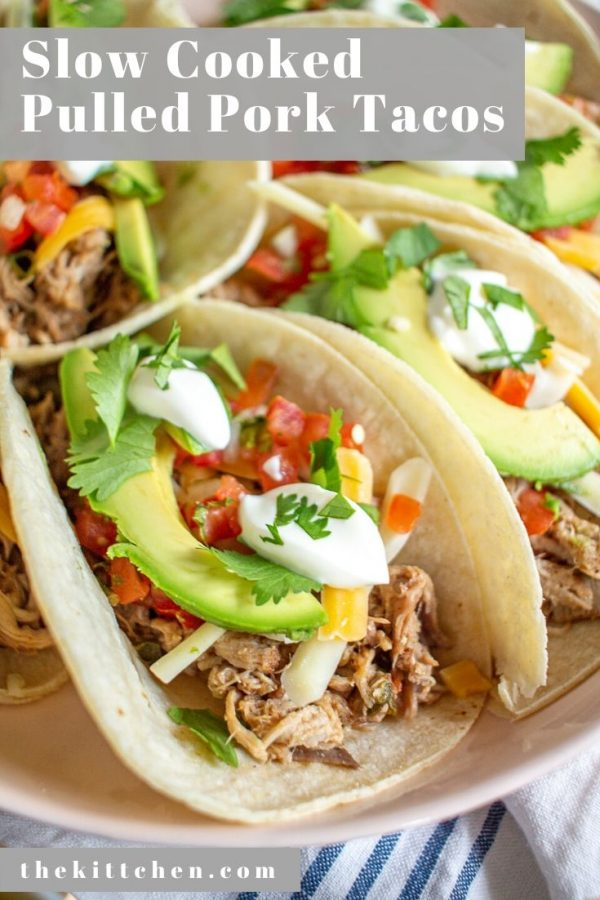 Slow Cooker Pulled Pork Tacos are made with juicy flavorful pulled pork, cheese, pico de gallo, slices of avocado, sour cream, and cilantro. It's a meal that involves minimal active preparation time but makes lots of food.